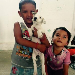 Children of Sarteneja with their puppy