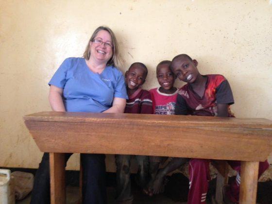 Dr Munn, FVAI volunteer, with young Tanzanians