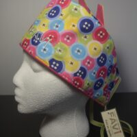 Surgical cap with ears-buttons