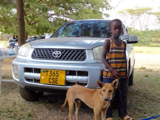 A young man with his friendly dog at FVAI clinic in Tanzania