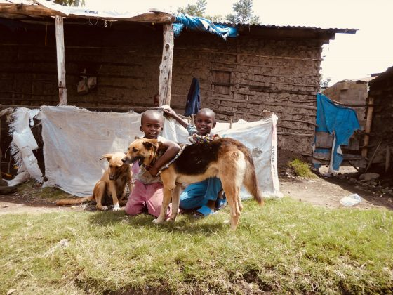 Young Tanzanians posing with their dog