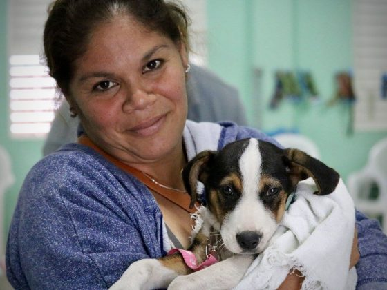A charming Belizean and her puppy in Patchakan, Belize